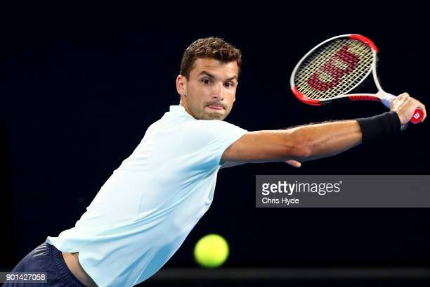 Grigor Dimitrovof of Bulgaria plays a backhand in his match against Kyle Edmund of Great Britain during day six of the 2018 Brisbane International at...