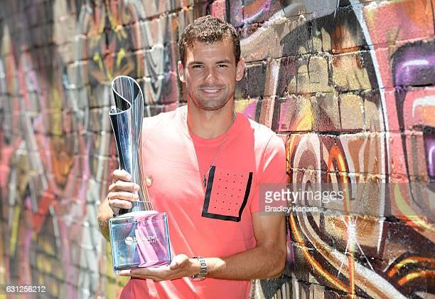 Grigor Dimotrov poses with the Men's 2017 Brisbane International winners trophy at Chur Burger on January 9, 2017 in Brisbane, Australia.