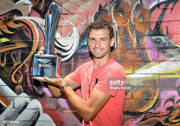Grigor Dimotrov poses with the Men's 2017 Brisbane International winners trophy at Chur Burger on January 9 2017 in Brisbane Australia