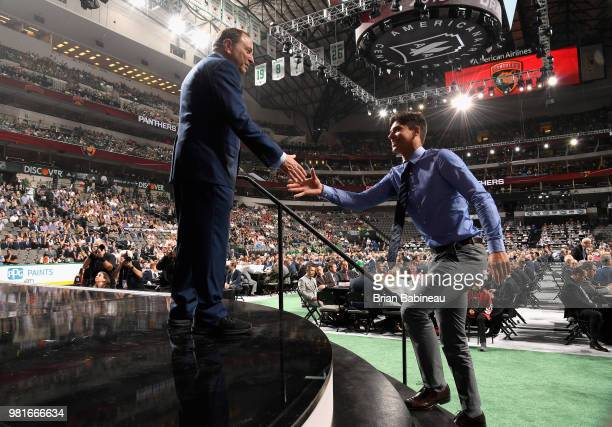 Grigori Denisenko greets NHL commissioner Gary Bettman after being selected fifteenth overall by the Florida Panthers during the first round of the...