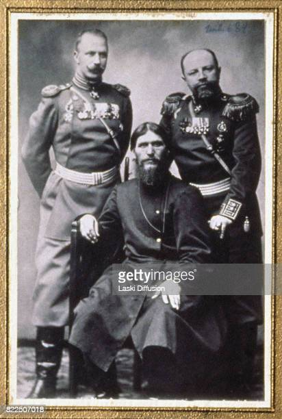 Grigori Rasputin Russian mystic and friend of the family of Tsar Nicholas II of Russia seated between prince Putiatin and colonel Dmitry Nikolaevich...