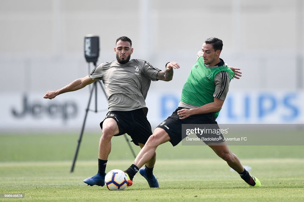 Grigoris Kastanos and Mattia De Sciglio during a Juventus training session at Juventus Training Center on July 12, 2018 in Turin, Italy.