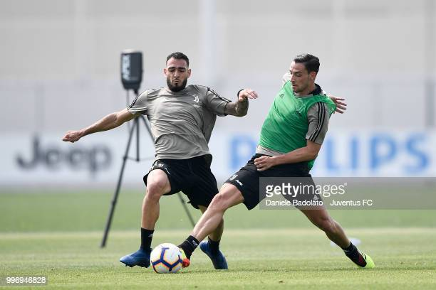 Grigoris Kastanos and Mattia De Sciglio during a Juventus training session at Juventus Training Center on July 12 2018 in Turin Italy