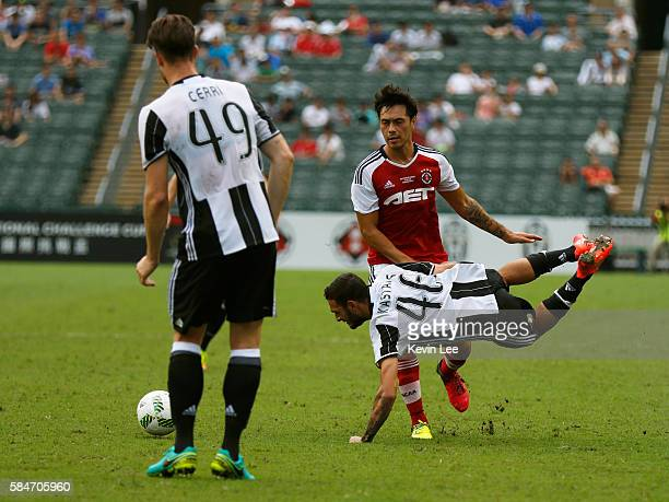 Grigoris Kastanos of Juventus FC tackles by Sean Ka Keung Tse of South China during the match between Juventus FC and South China of Hong Kong at...