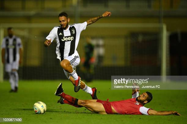 Grigoris Kastanos of Juventus U23 is challenged during the Coppa Italia Serie C match between Juventus U23 and Cuneo at Moccagatta Stadium on August...