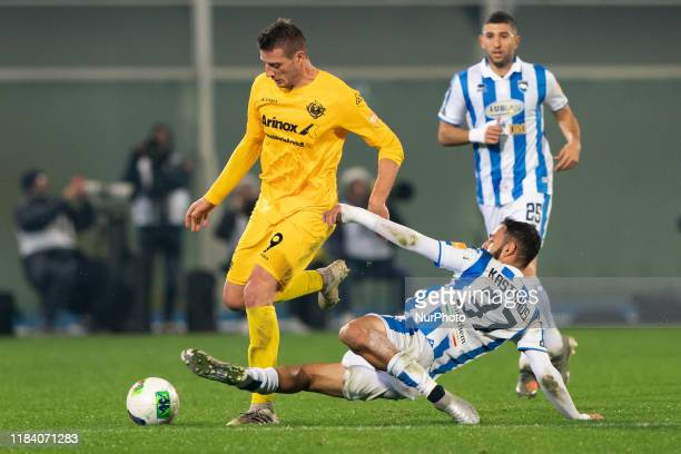 Grigoris Kastanos of Pescara Calcio 1936 and Daniel Ciofani US Cremonese battle for the ball during the Italian Serie B 2019/2020 match between...