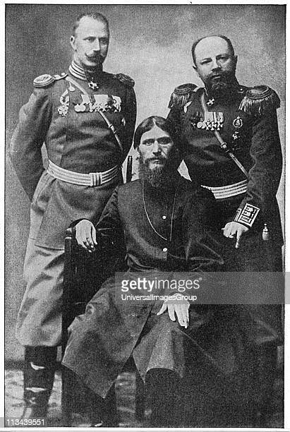 Grigoriy Efimovich Rasputin centre Russian mystic and 'holy man' who exercised influence over Nicholas II and the Tsarina seated between Colonel Loma...