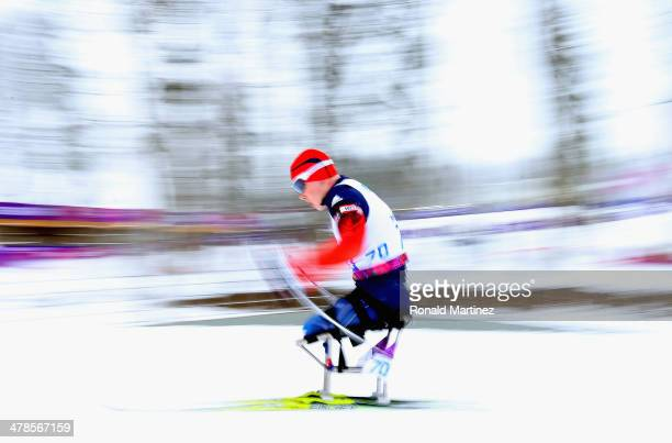 Grigory Murygin of Russia competes in the Men's 15km Sitting Biathlon during day seven of Sochi 2014 Paralympic Winter Games at Laura Crosscountry...