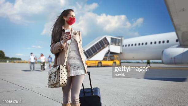 gril with face mask at the airport - austria stock pictures, royalty-free photos & images