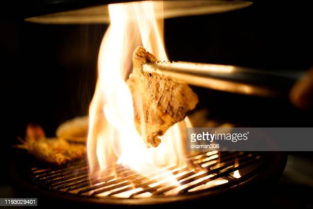 grill japanese wagyu  beef yakiniku style on fire and plate - 佐賀県 ストックフォトと画像