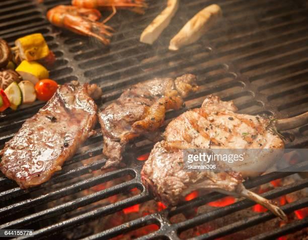 Grill rack lamb Australia medium rare steak on grill plate and vegetable grill