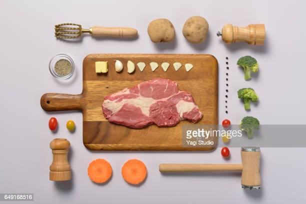 grilled beef knolling style - cooking utensil stock photos and pictures