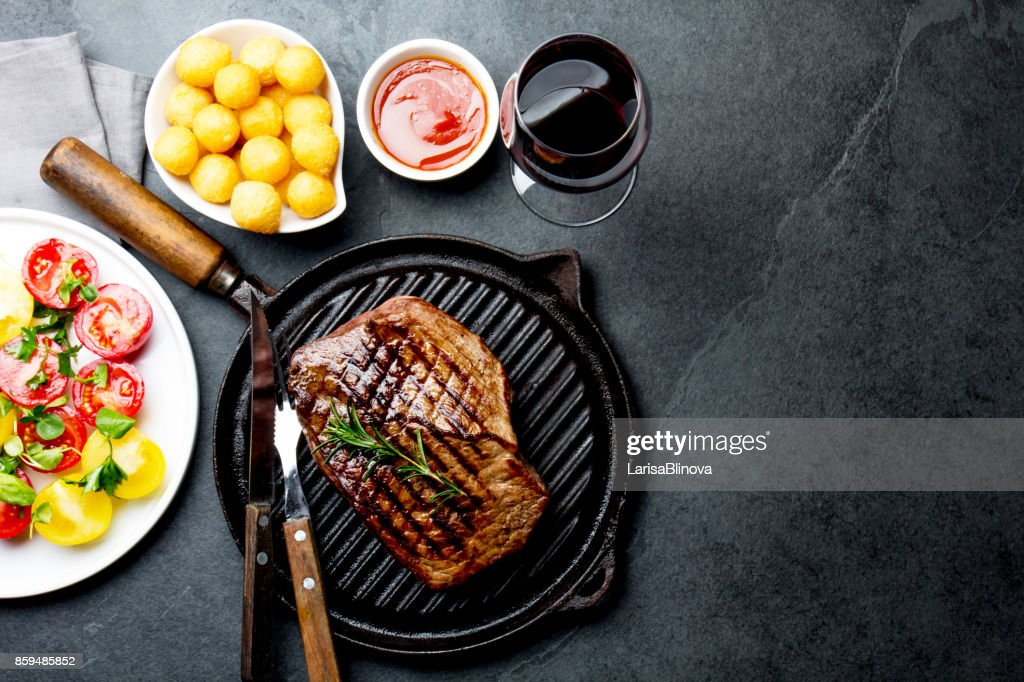 Grilled Beef Steak On Grill Pan Served With Tomato Salad