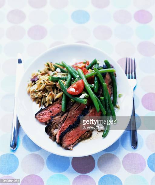 grilled butterflied leg of lamb with green-bean feta salad and toasted orzo - leg of lamb stock pictures, royalty-free photos & images