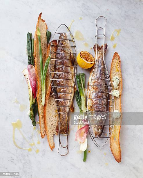 grilled charr with spring onions, herb butter & toasted bread - speckled trout stock photos and pictures