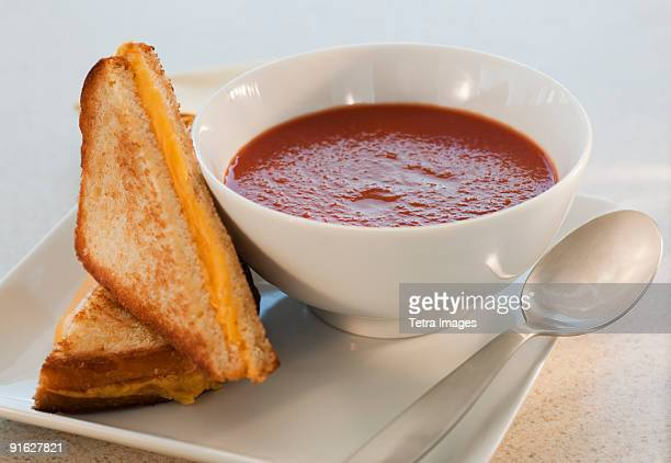 grilled cheese and tomato soup - tomato soup stock photos and pictures