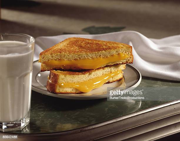 Grilled cheese sandwich and glass of milk