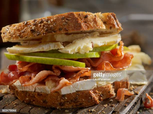 grilled cheese sandwich with bacon, brie and pear - brie stock photos and pictures