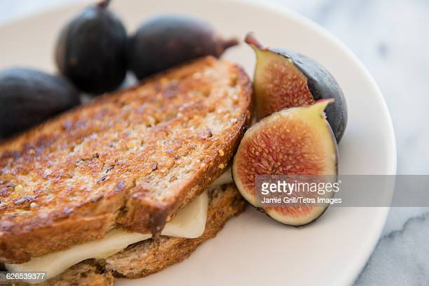 Grilled cheese sandwich with figs on plate