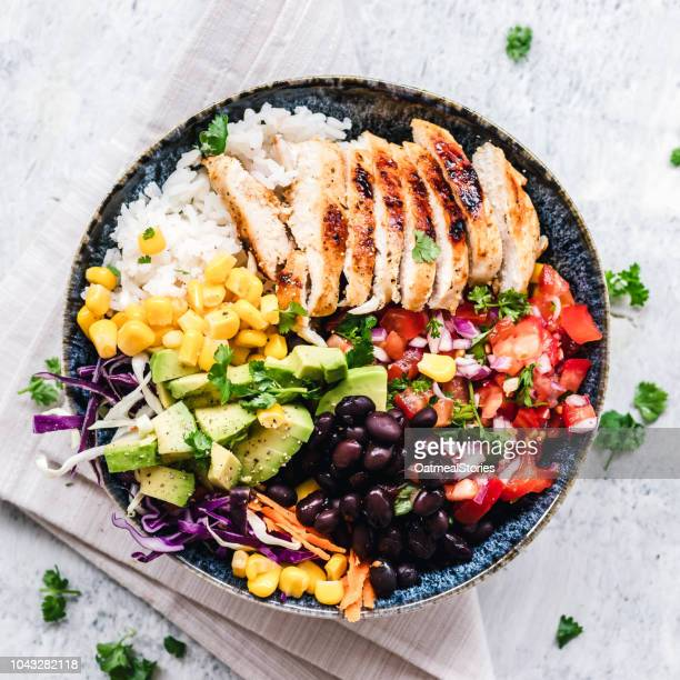 grilled chicken and rice salad bowl - food state stock pictures, royalty-free photos & images