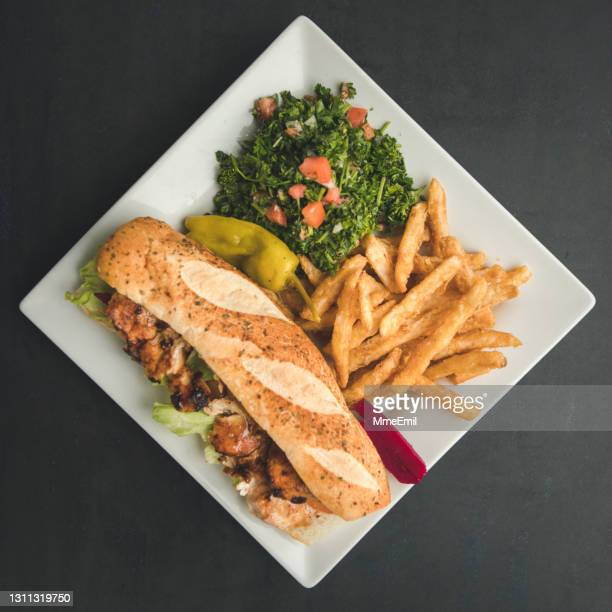 grilled chicken baguette sandwich with tabbouleh and french fries - mmeemil stock pictures, royalty-free photos & images