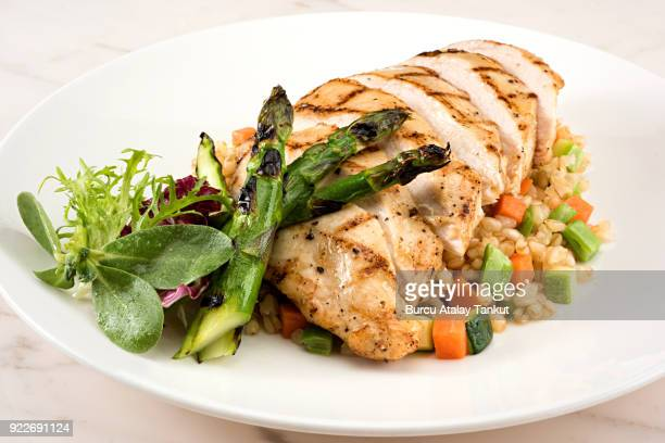 grilled chicken breast with garnish and asparagus - chicken meat stock pictures, royalty-free photos & images