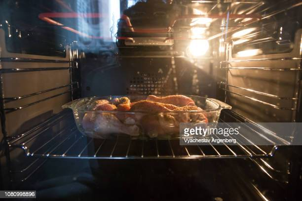 grilled chicken in electric oven, cooked to perfection - argenberg stock pictures, royalty-free photos & images