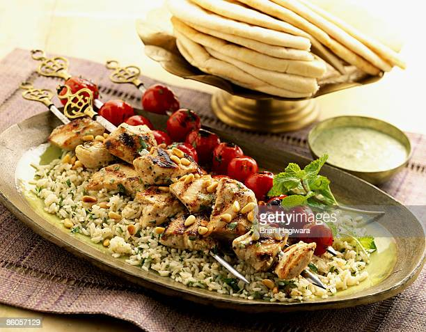 Grilled chicken kabob over rice