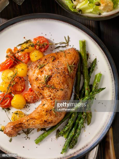 grilled chicken legs with vegetables - chicken leg stock photos and pictures