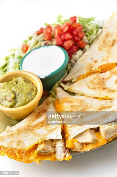 Grilled chicken quesadilla with guacamole and sour cream.