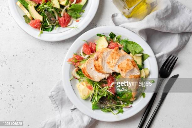 grilled chicken salad with avocado - salad stock pictures, royalty-free photos & images