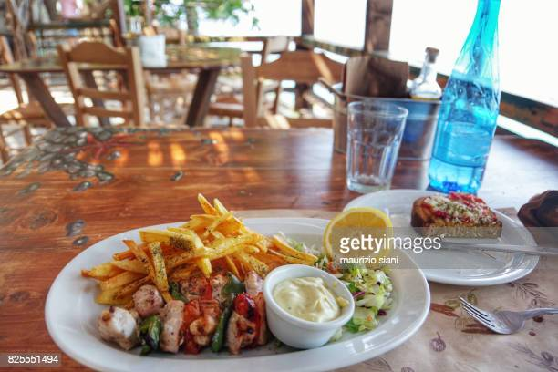 Grilled Chicken Souvlaki Served With French Fries