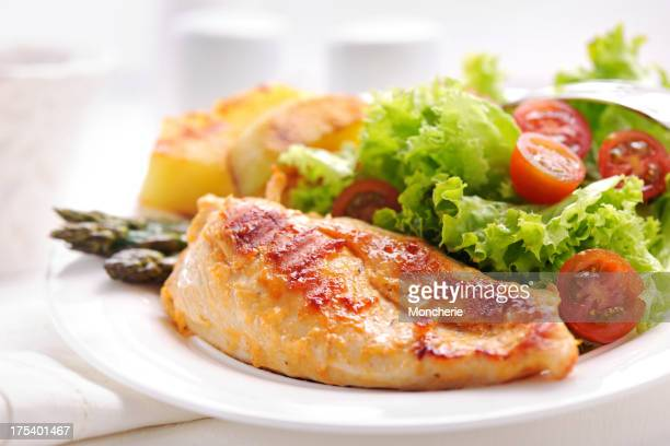 Grilled chicken steak with potatoes,asparagus and salad
