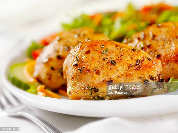 grilled chicken thighs with a side salad - meal stock pictures, royalty-free photos & images