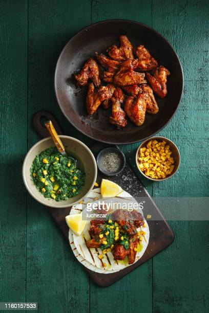 grilled chicken wings with green chilli and corn salsa - barbeque sauce stock photos and pictures