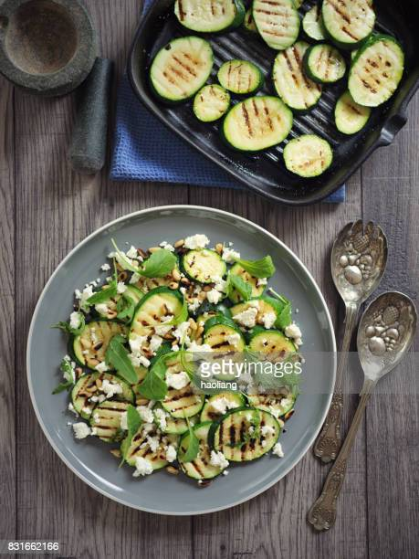 grilled courgette with pine nuts and feta cheese salad - zucchini stock pictures, royalty-free photos & images
