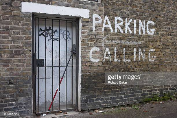 A grilled doorway and painted no parking message on 4th January London borough of Southwark England