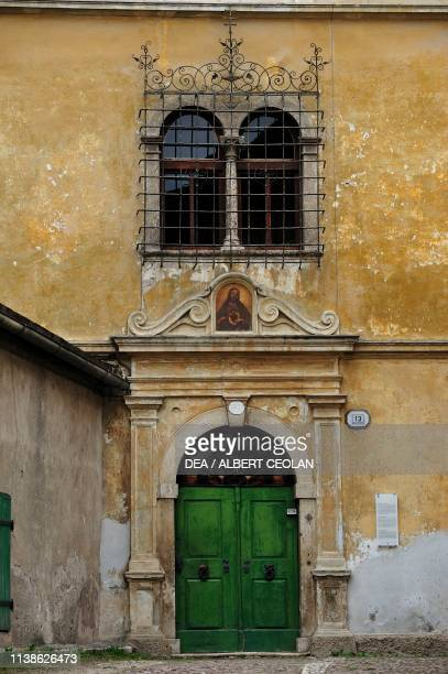Grilled double lancet window, detail of the An der Lan building, Salorno, Trentino-Alto Adige, Italy, 16th century.