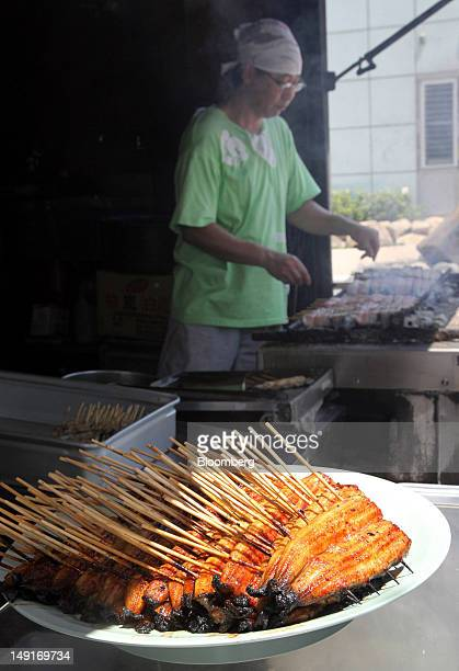 Grilled eels are displayed at a restaurant in Tokyo Japan on Thursday July 19 2012 The US government is considering regulating the international...