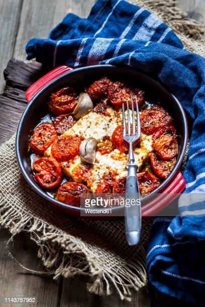 grilled feta cheese with tomatoes and garlic - feta cheese stock pictures, royalty-free photos & images