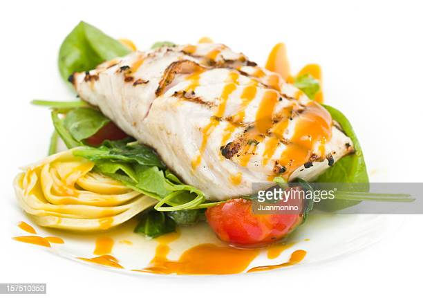 grilled fillet of fish with artichokes - dolphin fish stock pictures, royalty-free photos & images