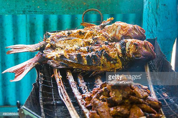 Grilled fish offered in a barbecue at the white sandy beach Grande Anse on September 25 2015 in La Passe La Digue Seychelles