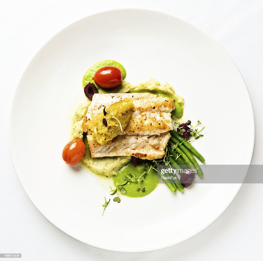 Grilled fish with lentil puree and vegetables seen from above : Stock Photo
