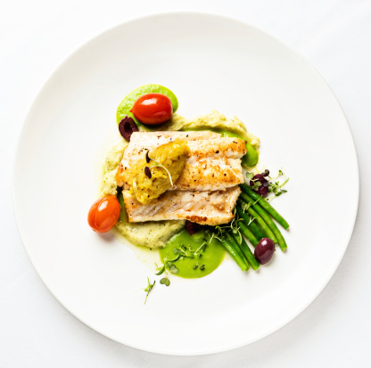 Grilled fish with lentil puree and vegetables seen from above 168613528