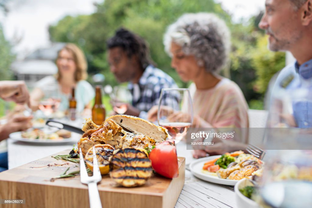 Grilled food on wooden board at garden party : Stock Photo