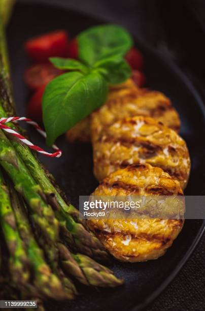 grilled green asparagus with tempeh - meat substitute stock pictures, royalty-free photos & images
