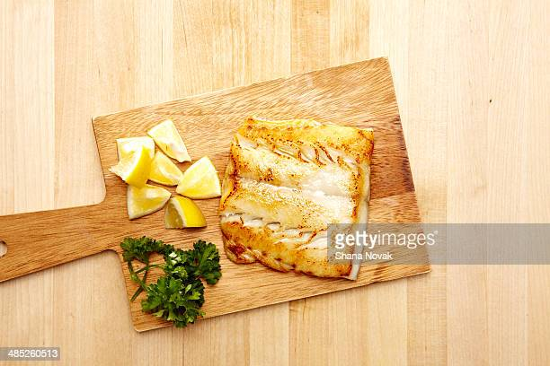 "grilled halibut on butcher's block - ""shana novak"" stock pictures, royalty-free photos & images"