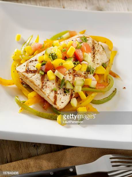 grilled halibut with mango salsa and roasted peppers - dolphin fish stock pictures, royalty-free photos & images