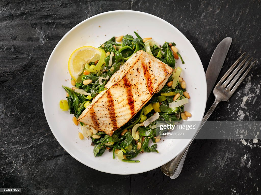 Grilled Halibut with Spinach, leeks and Pine Nuts : Stock Photo