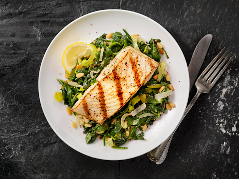 Grilled Halibut with Spinach, leeks and Pine Nuts 503337620